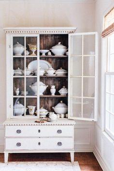 white cabinet dark interior