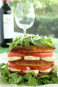 Fried Eggplant, Mozzarella and Tomatoes sit atop lightly-dressed peppery Arugula and sprinkled with freshly-grated Parmesan Cheese - the perfect appetizer to share or a meal in itself. http://www.loveandconfections.com/2015/06/eggplant-tomato-and-mozzarella-stack.html