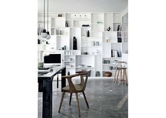Take advantage of the vertical space in your apartment by creating storage along your walls. This is a great way to store things like books and movies that you don't want to hide away, but that you don't use all too often. Click through to shop shelves that will maximize your storage space.