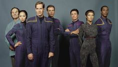 "Star Trek: Enterprise Cast Photo - Dr. Phlox (John Billingsley), Hoshi Sato (Linda Park), Captain Jonathan Archer (Scott Bakula), Charles ""Trip"" Tucker III (Connor Trinneer), Lt. Malcolm Reed (Dominic Keating), T'Pol (Jolene Blalock), & Travis Mayweather (Anthony Montgomery)"