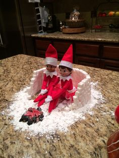 Elf in the shelf made an sugar cube igloo and candy campfire