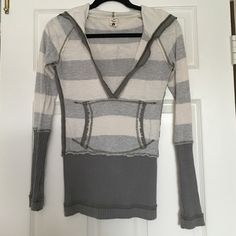 Free People striped v neck hooded sweater Very deep v neck sweater, perfect with a tank top underneath. Free People Sweaters V-Necks