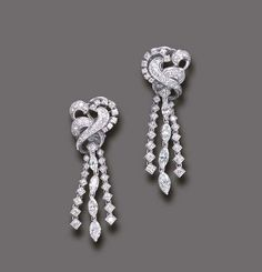 A PAIR OF DIAMOND EAR PENDANTS   Each designed as a circular-cut diamond scroll, suspending circular and marquise-cut diamond tassels, mounted in 18k white gold, with maker's marks