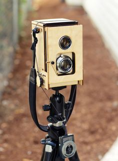 Wooden TLR Polaroid Camera This camera was made out of laser cut birch plywood and designed/developed by Kevin Kadooka, a Portland bred engineering student with good taste and a love for twin-lens reflex cameras