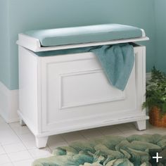 Place two of these at the foot of the bed. Bench aka hamper/storage unit.