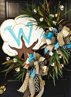 "This whimsical yet classic large wreath would be a great addition to your country home! Last Name, Initial or Saying can be added to the Cotton Boll! (Please list that in the Custom Text box)  This wreath is built on a 24"" round grapevine."