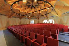 The main lecture theatre is formed through a geodesic structure – comprising glulam, steel nodes, CLT and wall cassettes. The wall cassette panels were assembled between the raking glulam columns. Standard larch glulam sized beams were double glued together to achieve the long curved members and steel and iroko timber were then used to construct an external ramp for disabled access