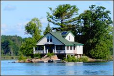 This cottage is on an island in Stoney Lake, located in Ontario's Kawarta Lakes Region in Peterborough County. Peterborough Ontario, Stony, Lakes, Canada, Cottage, Fire, Cabin, House Styles, Summer