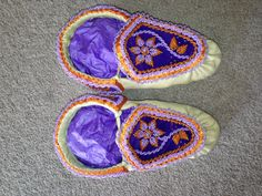 Purple and orange moccasin theme :) the latest from my personal sweatshop! Haudenosaunee raised beadwork moccasins! Love love love this pair! Cute designs on the cuff pieces also