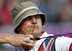 Britain's Simon Terry takes aim during the men's archery team eliminations at the Lords Cricket Ground during the London 2012 Olympics Games