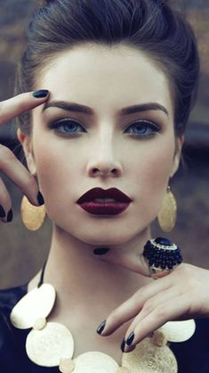 Simple but bold make up- dark brow, winged liner, deep colored matte lip