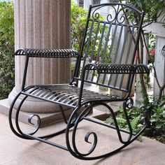 Rocking chair is constructed of durable iron Patio furniture features weather-resistant double powdercoated black finish Outdoor chair glides with a smooth rocking motion