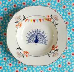 Arent these just beautiful upcycled plates........The peacock flowers and bunting plate by Ninainvorm on Etsy,
