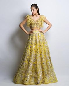 This yellow color wedding lehenga is featured in organza silk fabric embroidered with gotta patti. The blouse is embellished with gotta patti, beads and crystals. This lehenga set comes with a complimentary organza silk dupatta Gold Lehenga, Bridal Lehenga Choli, Lehenga Wedding, Lehnga Dress, Lehenga Blouse, Punjabi Wedding, Indian Dresses, Indian Outfits, Lehenga Collection