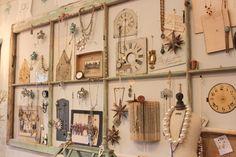 Salvaged door repurposed and used as a jewelry display - via 52 FLEA