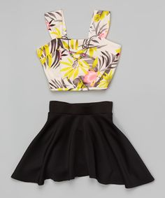 Just Kids Black Floral Crop Top Set - Girls | zulily - This pattern-kissed top's cropped cut slips on with ease, and the elastic-waistband skirt offers a comfy fit. A beaded necklace adds a touch of accessorized flair.