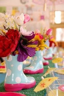 April Showers bring May flowers party decor.~~Watch for the little boots on sale, i would set a jar inside to hold the flowers
