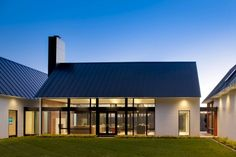 Vernacular Modernism - Though not officially a known style, this type of design interprets the form and massing of historic domestic buildings and adapts that with walls of glass, sophisticated lighting and machine made modern materials.