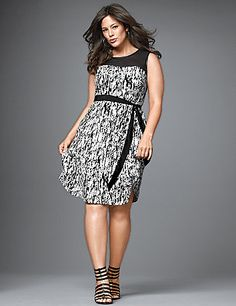 Graphic black & white shift dress is anything but neutral with a sheer illusion neckline and rich faux leather trim. The flattering silhouette is pulled together with a self-tie belt to define your shape. Back zipper with hook & eye closure.  lanebryant.com