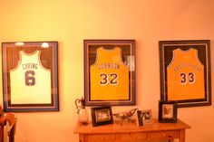 Love the framed jerseys for a teenage boy's room. Good idea in a couple of years. :)