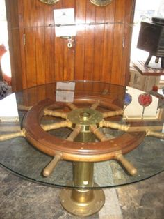 Beautiful Ship Wheel Converted Into A Table.