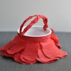 DIY Simple Red Petal May Basket by designmom: Made with a cleaned out yogurt cup and crepe paper!