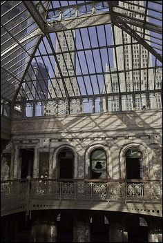 Abandoned Temple Court at 5 Beekman Street, the Woolworth building stands tall through the glass ceiling