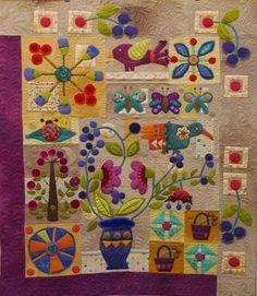 "Quilting by Karen Terrens.  Customer quilt, ""In Full Bloom"" design by Sue Spargo."