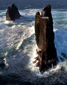 How would you like to be a lighthouse guard in this lighthouse? Þrídrangar is located 10km west of the Westman Islands and the lighthouse was built in 1939 (probably the most challenging lighthouse ever built in Iceland). Image via www.sigling.is ....