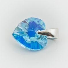 Swarovski Heart Pendant 10mm Aquamarine AB  Dimensions: length: 1,4cm stone size: 10mm Weight ~ 0,72g ( 1 piece ) Metal : sterling silver ( AG-925) Stones: Swarovski Elements 6228 10mm Colour: Aquamarine AB 1 package = 1 piece Price 5.49 PLN
