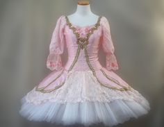 This Princess Aurora tutu is one of the most precious creations of our store. Reproducing exactly the royal style of the time, this costume is a real masterpiece. The bodice is made with silk pink sha