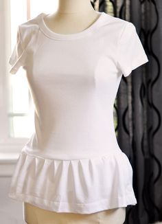 Peplum tshirt DIY 1 by ...love Maegan, via Flickr  (kept the length on the original fitted T so it cold be tucked in.. LOVE that idea!)