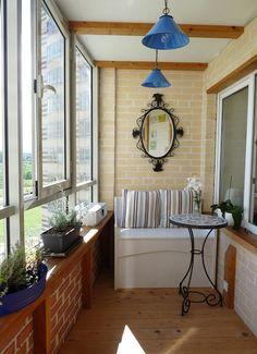 Enclosed balcony...I like the little shelf along the window