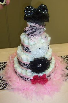 Damask baby shower cake- has hair bows on front as an additional gift to baby-to-be