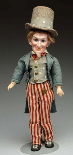 "Lot: 14"" Bisque ""Uncle Sam"" Character Doll by C.O.D., Lot Number: 0005, Starting Bid: $375, Auctioneer: Dan Morphy Auctions, Auction: Toys, Trains, Marbles & Dolls Sale Day 1, Date: September 10th, 2015 MST"