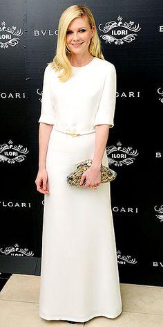 Kirsten Dunst in Derek Lam Spring 2012 dress and Bvlgari 'Aida' clutch at the Bvlgari Le Gemme eyewear collection launch, October 2011