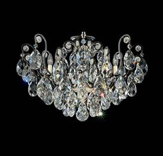 THIS BAROQUE STYLE OF CHANDELIER DATES BACK TO THE COURT OF KING LOUIS XIV IN THE SEVENTEENTH CENTURY. THE BOLD MIX OF CRYSTAL TRIMS AND FINISHES ADDS A FLAVOR OF TWENTY-FIRST CENTURY ECLECTICISM. MADE WITH SWAROVSKI ELEMENTS. PERFECT FOR: DINING LIVING ENTRANCE/FOYER. Item # SCH 3785/H/48 .