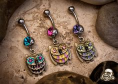I want these!! Owl Bellybutton rings