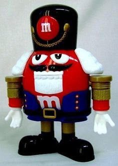 M&M's Candy Dispenser Nutcracker Sweet. Red has dressed as a character in the famous ballet, the Nutcracker Suit, and is ready to dispense all the M&M candies you can eat. #M&M #candydispenser