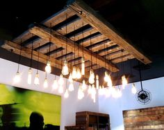 Designer Spotlight: Jonathan Waud... on the blog today! Check out his beautiful lighting fixtures made from reclaimed wood and metals!