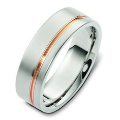 14Kt white gold with a rose gold stripe, comfort fit, 7.0mm wide wedding band.