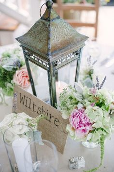 love the lantern centerpiece... I would like to do mini lighthouses instead though!