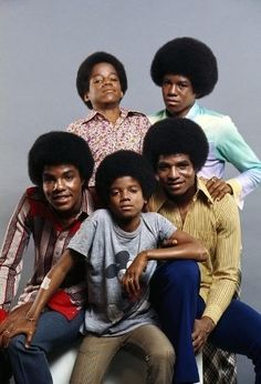 I wish all of them were smiling! LOL I do like the pic tho--like they have one another's back...Jackson 5