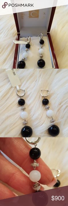 BLACK AND WHITE ONYX DIAMOND EARRINGS NIB.  NEVER WORN. NO FLAWS. AUTHENTIC  These earrings were purchased at a Auction gala. Given to me by my husband. They are 2 inches long.   Comes in original box. Purchased in Dallas.  Name of jeweler:  Cook Diamonds  Looking for my original receipt and appraised value. Jewelry Earrings