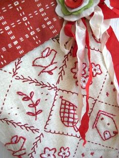 "cute little embroidery motifs and I love the different boarder ""lines"" - - - Red Thread..."