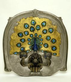 Peacock sconce, ALEXANDER FISHER, c. 1899, steel, bronze, brass and silver, with enamelled decoration  |  V&A Museum