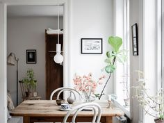 my scandinavian home: An Idyllic Swedish Apartment In A Hidden Courtyard Retro Sofa, Swedish Cottage, Swedish House, White Washed Floors, White Walls, Fishermans Cottage, Cottage Kitchens, Scandinavian Living, Wooden Cabinets