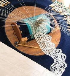 Bobbin lace in progress. I love watching people making lace