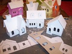 Little paper houses for a Christmas village by Juxtapost. Do one of the Amherst village for the mantle?