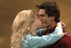 7 Awesomely Awkward Shots of Emma Stone and Andrew Garfield Kissing on 'SNL' - For The Win - Zimbio